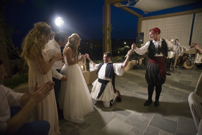 Bride and Greek dancers show at costa navarino wedding greece