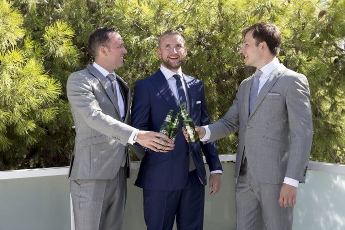 Groom and friends in a destination summer wedding in Greece