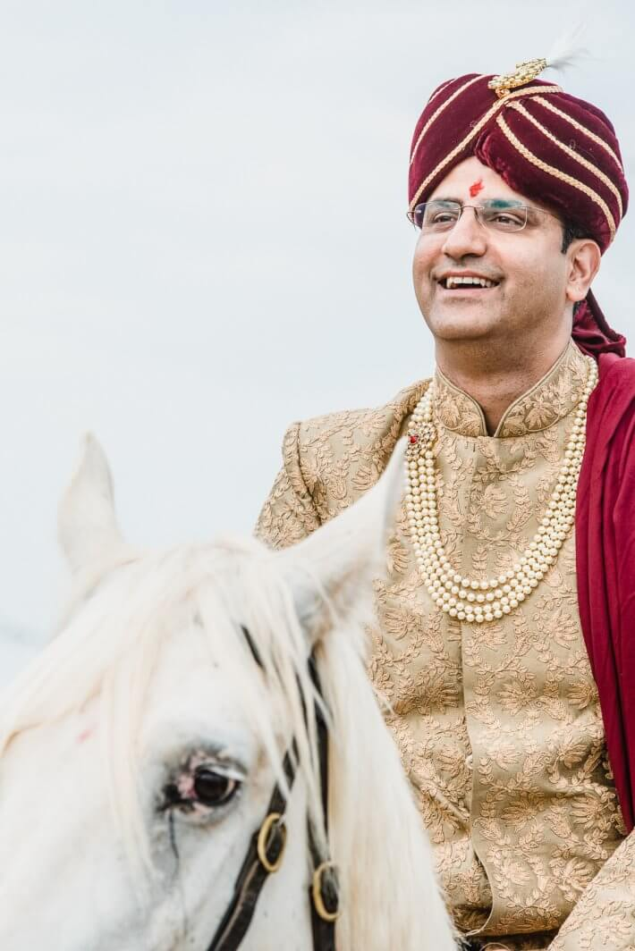 Groom Baraat coming with a white horse for Religious ceremony