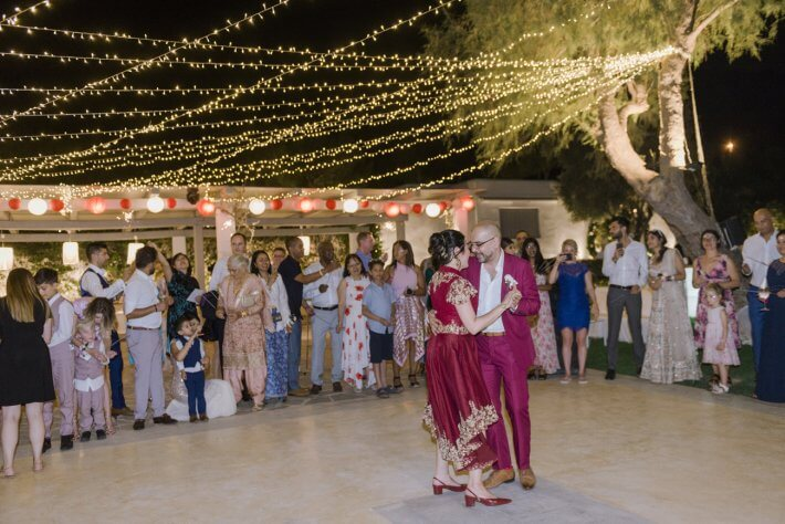 First dance with fairy lights in multicultural wedding Athens greece