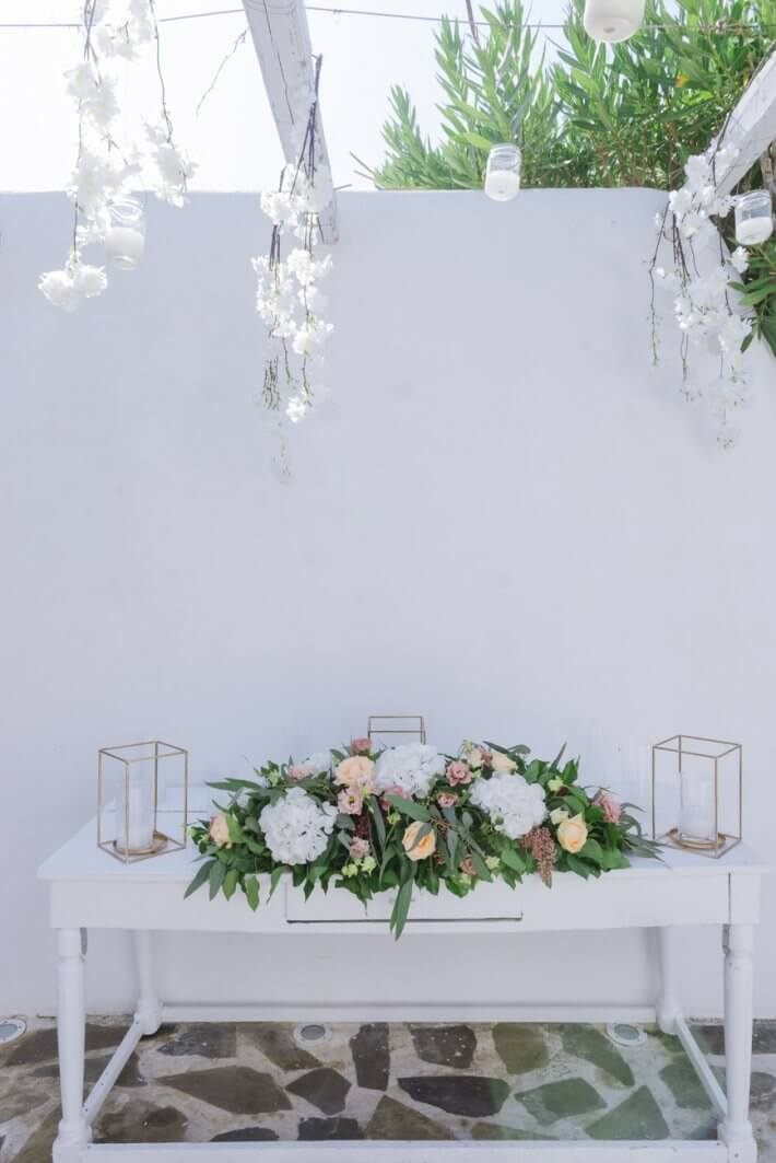 Tabletop flower decoration with greenery and light colour flowers