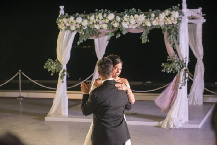 First dance in Santorini wedding venue for Cierra and Luis