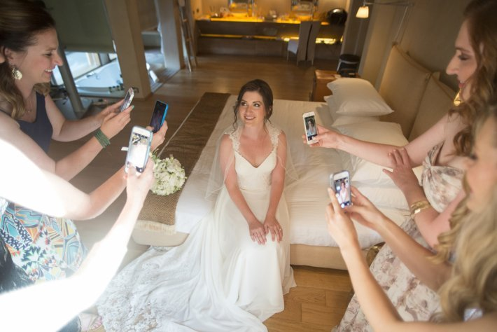 Bride preparation with friends in venue bridal room, Athenian Riviera, Greece
