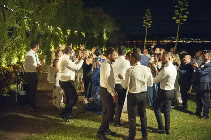 Guests are welcoming bride and groom in destination lebanese wedding in athens greece