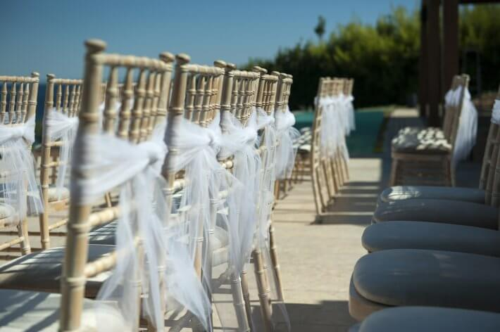 tifanny's chairs in ceremony area for a lebanese destination wedding in athens riviera greece