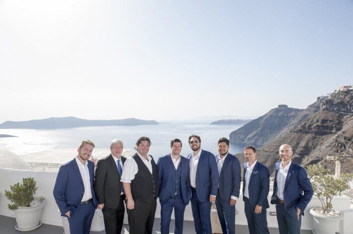Groom and groomsmen in Santorini wedding caldera view