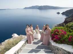 Bride and bridesmaids in Oia Santorini wedding