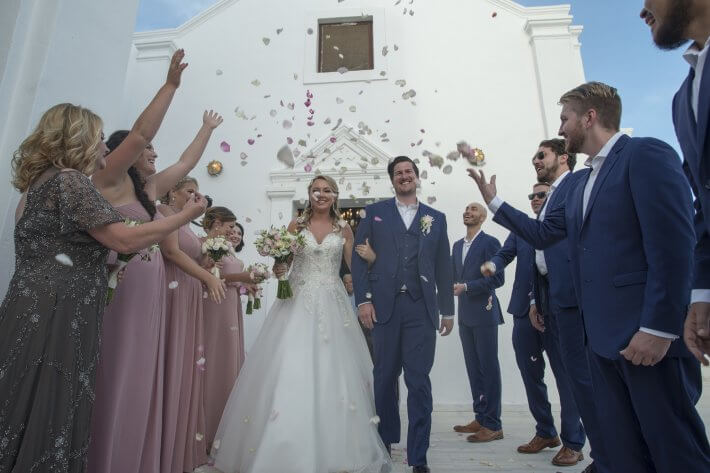 Petals throwing in Religious Orthodox wedding in Santorini