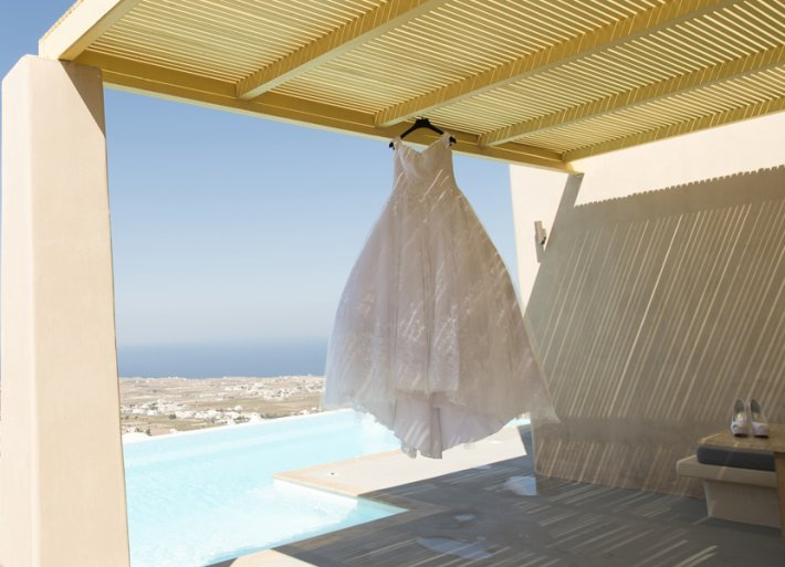 Bridal dress in Santorini caldera hotel before wedding
